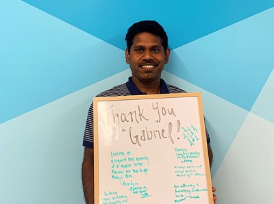 Man holding a thank you sign