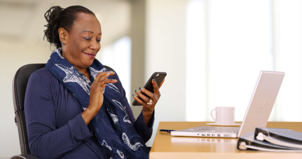 Older woman looking at her phone